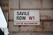 Street sign for the famous Saville Row. This street is best known for it's tailors. Tailoring and suit making.