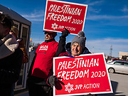 08 JANUARY 2020 - DES MOINES, IOWA: Protesters for Palestinian rights picket the front of Vice President Joe Biden's campaign office in Des Moines. A group of young people from across the US are in Des Moines this week conducting pickets and protests at campaign events for the Democratic presidential candidates. The protests are being organized by Jewish Voice for Peace Action.               PHOTO BY JACK KURTZ