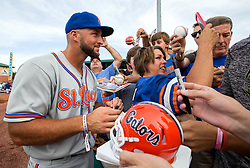 July 7, 2017 - Jupiter, Florida, U.S. - St. Lucie Met Tim Tebow poses for a selfie with a fan while signing autographs before game against the Jupiter Hammerheads at Roger Dean Stadium in Jupiter, Florida on July 7, 2017. (Credit Image: © Allen Eyestone/The Palm Beach Post via ZUMA Wire)