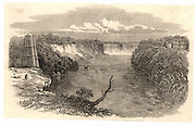 Construction of a suspension bridge at the Niagara Falls, North America.  Temporary timber towers and rope basket ferry in operation, establishing a temporary link between the two banks. From 'The Illustrated London News'(London, 17 February 1849).