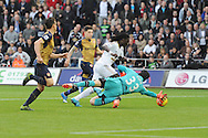 Bafetimbi Gomis of Swansea is denied by a save from Arsenal goalkeeper Petr Cech early in 1st half. Barclays Premier league match, Swansea city v Arsenal  at the Liberty Stadium in Swansea, South Wales  on Saturday 31st October 2015.<br /> pic by  Andrew Orchard, Andrew Orchard sports photography.
