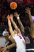 DALLAS, TX - JANUARY 04:  Dashawn McDowell #5 of the SMU Mustangs drives to the basket against Mark Williams #10 and Daniel Dingle #4 of the Temple Owls during a basketball game on January 4, 2017 at Moody Coliseum in Dallas, Texas.  (Photo by Cooper Neill/Getty Images) *** Local Caption *** Dashawn McDowell; Mark Williams; Daniel Dingle
