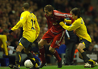 Photo: Paul Greenwood.<br />Liverpool v Arsenal. The FA Cup. 06/01/2007. Liverpool's Peter Crouch, centre, battles with Arsenal's Tomas Rosicky