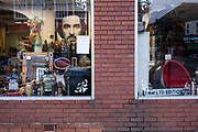 Poster of actor Al Pacino looks out from a second hand shop selling all manner of curiosities in Kings Heath on 21st November 2020 in Birmingham, United Kingdom.