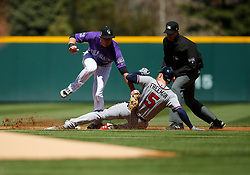 April 8, 2018 - Denver, CO, U.S. - DENVER, CO - APRIL 08: Atlanta Braves Infielder Freddie Freeman (5) slides into second base with a double as Colorado Rockies infielder DJ LeMahieu (9) is late with the tag during a regular season MLB game between the Colorado Rockies and the visiting Atlanta Braves on April 8, 2018 at Coors Field in Denver, CO. (Photo by Russell Lansford/Icon Sportswire) (Credit Image: © Russell Lansford/Icon SMI via ZUMA Press)
