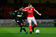 Rhys Browne (9) of Yeovil Town battles for possession with Chris Hussey (3) of Swindon Town during the EFL Sky Bet League 2 match between Swindon Town and Yeovil Town at the County Ground, Swindon, England on 10 April 2018. Picture by Graham Hunt.