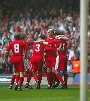 Photo: Scott Heavey<br />Wales V Azerbaijan. 29/03/03.<br />The Welsh team celebrate after their opening minute goal during this afternoons Euro 2004 Group 9 qualifying match at the Millenium Stadium in Cardiff.