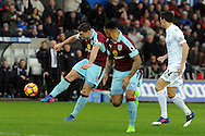 Burnley's Sam Vokes (9) shoots at goal. Premier league match, Swansea city v Burnley at the Liberty Stadium in Swansea, South Wales on Saturday 4th March 2017.<br /> pic by  Carl Robertson, Andrew Orchard sports photography.