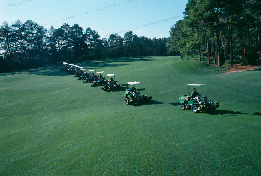 Greenskeepers maintaining the fairway at Augusta National Golf Club, in Augusta Georgia, home of the PGA Masters Tournament.