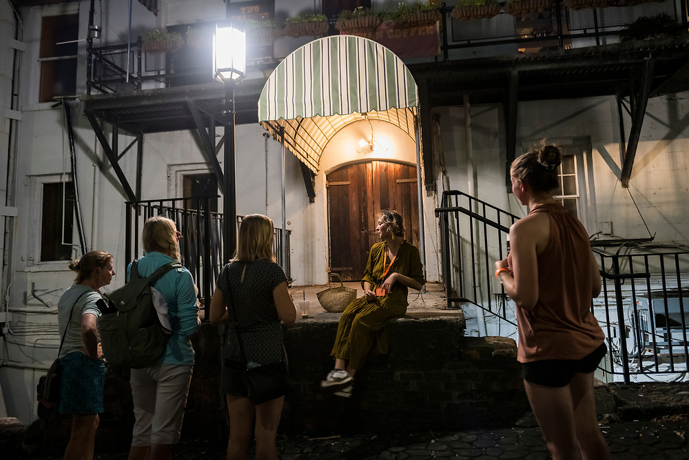Savannah, Georgia - July 28, 2021: Hannah Eyre leads a small group of visitors on a ghost tour in Savannah