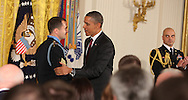President Barack Obama presents the Medal of Honor to Staff Sargeant Salvatore Giunta.  The Ceremony was held in the East Room of the White House on November 16, 2010.  Photograph by Dennis Brack